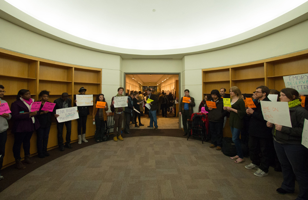 Silent protestors convene at the entrance to the opening celebration of the new SCLC exhibit.
