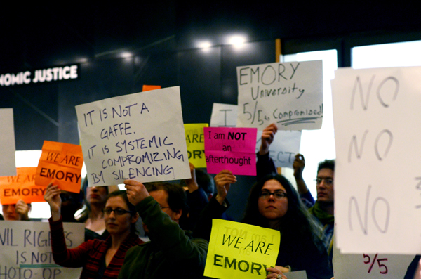 Students and faculty members take part in a silent protest during the opening of the SCLC exhibit.