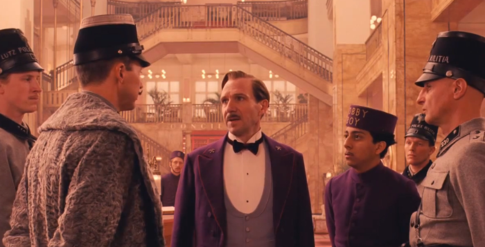 "Courtesy of Scott Rudin Productions Ralph Fiennes (center) stars in writer/director Wes Anderson's latest effort ""The Grand Budapest Hotel."" The film also features Tilda Swinton, Bill Murray, Jude Law, Adrien Brody and many more."
