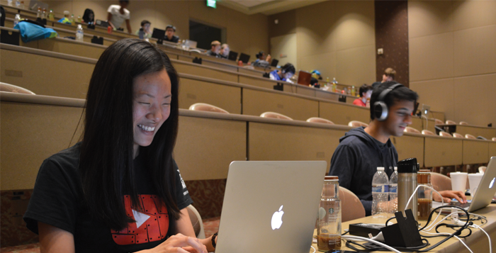 Photo by Jenna Kingsley College senior Christal Wang (left) and Georgia Institute of Technology sophomore Kush Patel (right) worked on   their app, PhotoSinc, Saturday night at the Emory Hackathon.