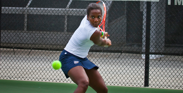 Courtesy of Emory Athletics Senior Gabrielle Clark fiercely returns a shot. Clark and the Eagles did not lose a set in their singles competitions in their outing against Brenau University last Tuesday.