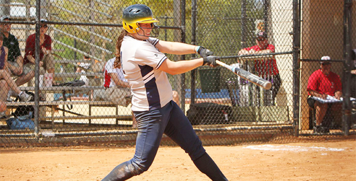 Courtesy of Emory Athletics Senior first baseman Megan Light knocks a ball into play. Light had five RBIs in the first game of a Saturday doubleheader against Maryville College (Tenn.). The Eagles won the first game of the doubleheader 10-1, and lost the second 4-0. The team is now waiting to hear their postseason fate.