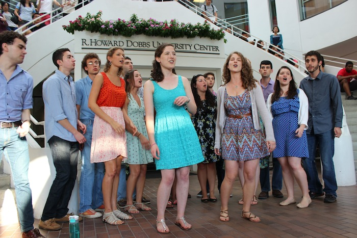 "College senior Julia Ingram and College junior Gabrielle Bloch lead ChaiTunes in performing a mash-up of ""Landslide"" and ""If I Die Young"" at the year's inaugural First Friday. / Photo By Julia Munslow, Staff Writer"