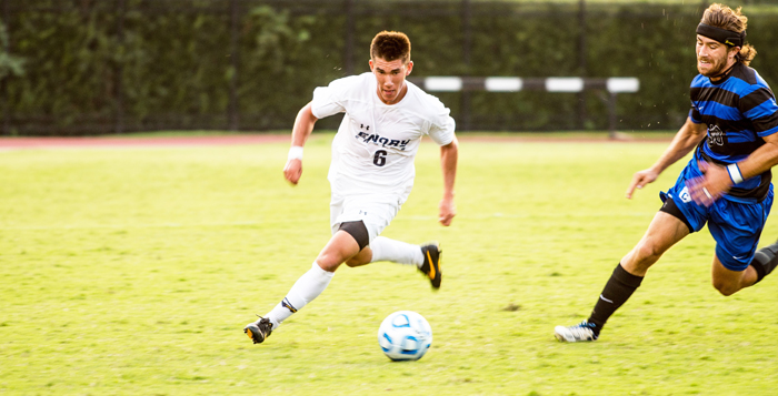 Junior midfielder Nick Schook runs the ball around a defender. Schook and the Eagles will take on the Panthers at Birmingham-Southern College (Ala.) Wednesday and try to extend their win-streak to eight games. Their record on the season is 7-0-1. | Courtesy of Emory Athletics