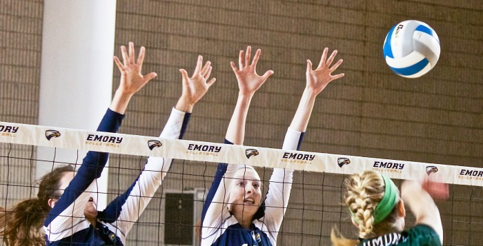 Sophomore right side hitter Sarah Maher (Left) and senior middle hitter Cat McGrath (Right) go up for the block. Maher, McGrath and the Eagles shut down Piedmont College (Ga.) 3-0 on Wednesday to bring their record to 28-3 on the season. | Photo By Jason Oh/Staff