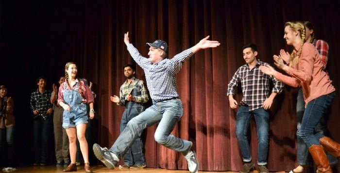 College freshman Jay Gillen (center) performs in