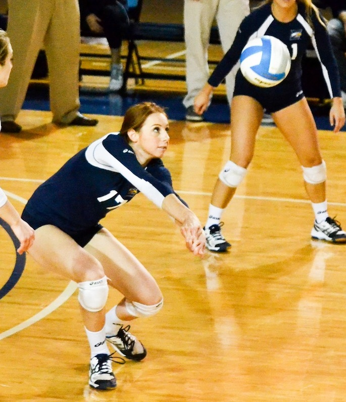 Sophomore outside hitter Sheridan Rice hits the ball. Rice and the Eagles are now 31-3 on the season. | Photo by Erin Baker, Staff Photographer